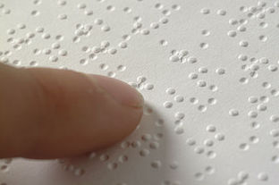 Photo of person reading braille