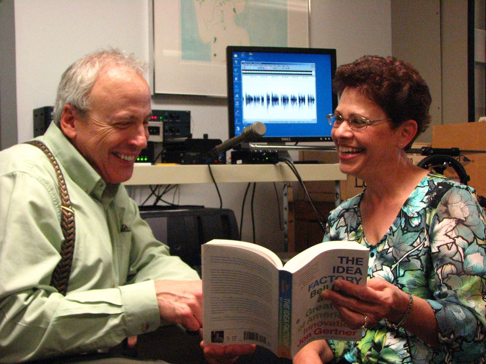 Photo of two Auidiovision volunteers, James Degnen and Nancy Reffner, preparing to record a book for TBBC members.