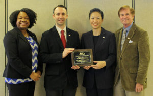 Accepting the NJLA Information Literature Award were, from left:  Tiffany McClary, director of Communications, Marketing and Outreach, Anthony Schiavino, graphic designer, webmaster and communications specialist, Mimi Lee, consultant for Diversity and Literacy Services, Gary Cooper, public relations and news media contact.
