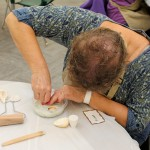 During the Texture Casting Workshop, Susan uses shells to make impressions in a mold.