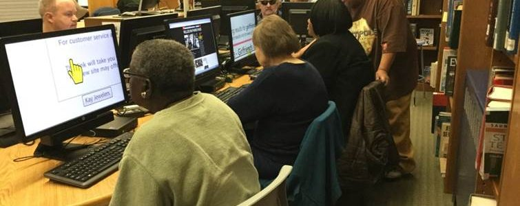 Photo of people receiving assistive tech training on computers at the South Orange Public Library