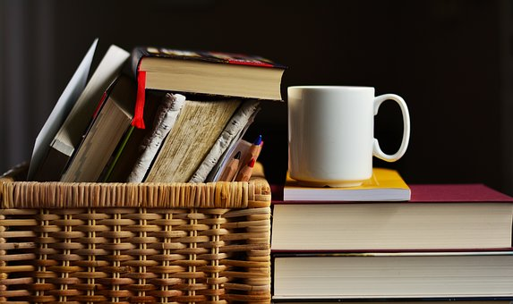Image of a basket of books with a cup of tea